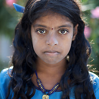 "Vijyashree Viswanathan on a morning before school at home in the fishing village of Thazanguda...Vijita (age 14) and Vijyashree (age 11) Viswanathan lost their mother and brother to the tsunami in 2004. They continue to live in the fishing village of Thazanguda with their father Viswanathan, his second wife Kayalvizhi and their two children Sanjay (age 3) and Monica (age 1). ..Until the beginning of the 2009 academic year in June, Vijita and Vijyashree attended the local Thazanguda school. This village school teaches pupils only until the 8th Standard and with Vijita now entering the 9th, it was decided that the two daughters remain together and both travel 3km to the local town school: the Government Girls High School, Venugopalapuram in Cuddalore. ..At the same time Viswanathan decided he would cease day-to-day care of his daughters and place them in the Government Home for Tsunami Children, also in Cuddalore. This was not a move welcomed by either Vijita or Vijyashree and one afternoon after just two weeks at the orphanage, the two girls ran away. At roll call in the orphanage that evening the alarm was sounded and the two sisters were eventually located in Thazanguda waiting for their father and Kayalvizhi who were both away at the time. Realising his daughters' unhappiness, Viswanathan then took them out of the Government home. ..According to her class teacher, Vijita often compares her step-mother to her mother and concludes that she wants her mother back. Vijita confides in her teachers that her stepmother is forever demanding that she and her sister Vijyashree undertake housework. This frustration at home is tempered by the genuine love both sisters have for their father and two younger siblings Sanjay and Monica. Vijita expresses a lonelyness without her mother. Pushpavalli concludes that ""Vijita wants something else beyond the love of her father and sister"". ..Viswanathan appears genuinely to want the best for his two elder daughters. His experiment enroll"