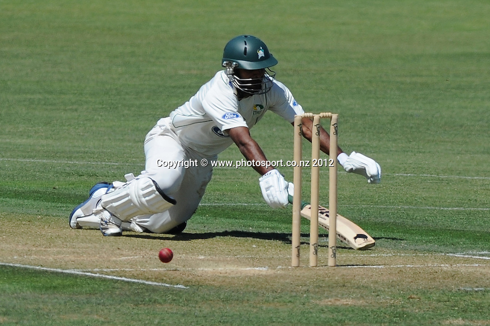 Central Stag's Tarun Nathula dives to avoid being run out in the Plunket Shield match, Central Districts vs Otago, Napier, New Zealand. Tuesday 27 November 2012. Photo: Kerry Marshall / photosport.co.nz