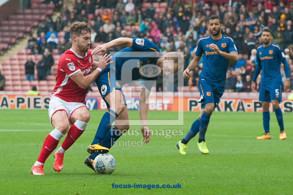 Sebastian Larsson of Hull City shields the ball from Tom Bradshaw of Barnsley during the Sky Bet Championship match at Oakwell, Barnsley<br /> Picture by Matt Wilkinson/Focus Images Ltd 07814 960751<br /> 21/10/2017