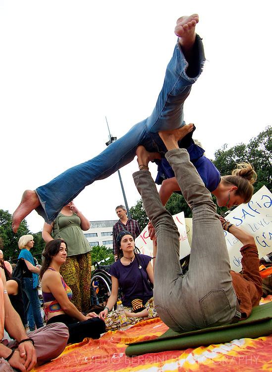 Indignados performing acrobatic yoga in Plac?a de Catalunya