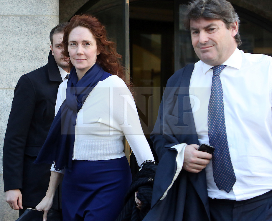© Licenced to London News Pictures. 20/02/2014. London. UK.  <br /> Former News of the World editor Rebekah Brooks is pictured leaving the Central Criminal Court with her husband Charlie during her week of giving evidence at the phone-hacking trial at the Old Bailey in London, February 20th 2014.<br /> Photo Credit: Susannah Ireland