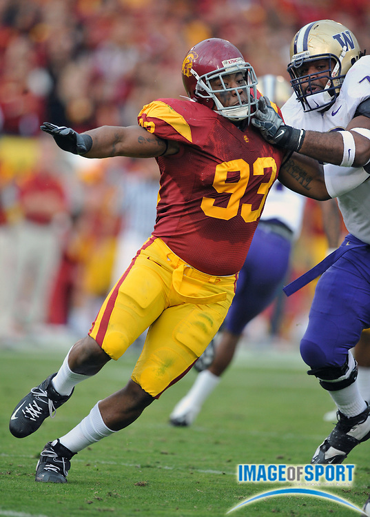 Nov 1, 2008; Los Angeles, CA, USA; Southern California Trojans defensive end Everson Griffin (93) tries to get past Washington Huskies left tackle Ben Ossai (79) at the Los Angeles Memorial Coliseum. USC defeated Washington 56-0.