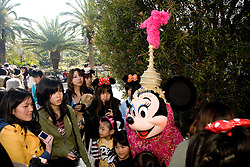 Asia, Japan, Tokyo, DisneySea resort, Minnie Mouse is mobbed by a crowd of fans