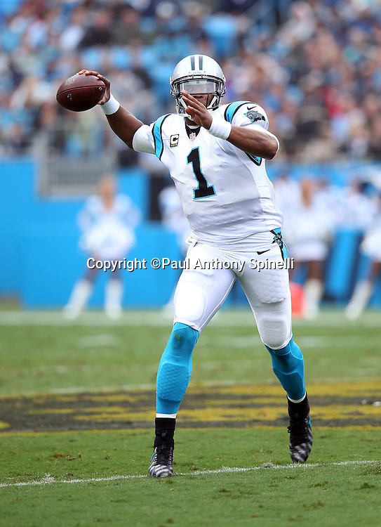 Carolina Panthers quarterback Cam Newton (1) throws a first quarter pass during the 2015 NFL week 3 regular season football game against the New Orleans Saints on Sunday, Sept. 27, 2015 in Charlotte, N.C. The Panthers won the game 27-22. (©Paul Anthony Spinelli)