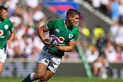 Ireland player Garry Ringrose looks for space to kick the ball in the first half  during the England vs Ireland warm up fixture at Twickenham, Richmond, United Kingdom on 24 August 2019.