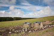 Cattle water troughs in a field near Stranrear, Scotland
