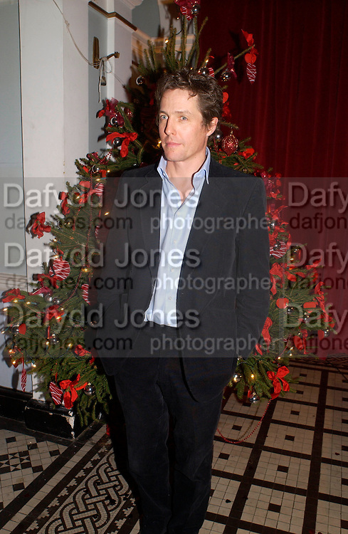 Hugh Grant, 'Love Actually after premiere party. the Old In and Out club, Piccadilly, 16 November 2003. © Copyright Photograph by Dafydd Jones 66 Stockwell Park Rd. London SW9 0DA Tel 020 7733 0108 www.dafjones.com