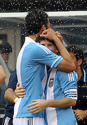 JUNE 09 2012:   Federico Fernandez (17) of Argentina with Lionel Messi (10) after he had scored his third goal against Brazil during an international friendly match at Metlife Stadium in East Rutherford,New Jersey. Argentina won 4-3.