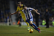 Brighton & Hove Albion winger Jamie Murphy (15) and Luke Ayling during the EFL Sky Bet Championship match between Brighton and Hove Albion and Leeds United at the American Express Community Stadium, Brighton and Hove, England on 9 December 2016.