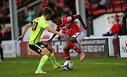 Walsall defender, Rico Henry and Brighton striker, Solomon March battle it out during the Capital One Cup match between Walsall and Brighton and Hove Albion at the Banks's Stadium, Walsall, England on 25 August 2015.