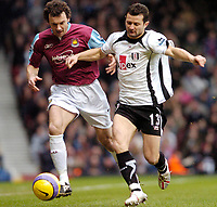 Photo: Leigh Quinnell.<br /> West Ham United v Fulham. The Barclays Premiership. 13/01/2007. Fulhams Tomasz Redzinski battles with West Hams Christian Daily.