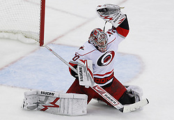 Apr 23, 2009; Newark, NJ, USA; Carolina Hurricanes goalie Cam Ward (30) makes a save during the third period of game five of the eastern conference quarterfinals of the 2009 Stanley Cup playoffs at the Prudential Center. The Devils beat the Hurricanes 1-0 to take a 3-2 lead in the best of 7 series.