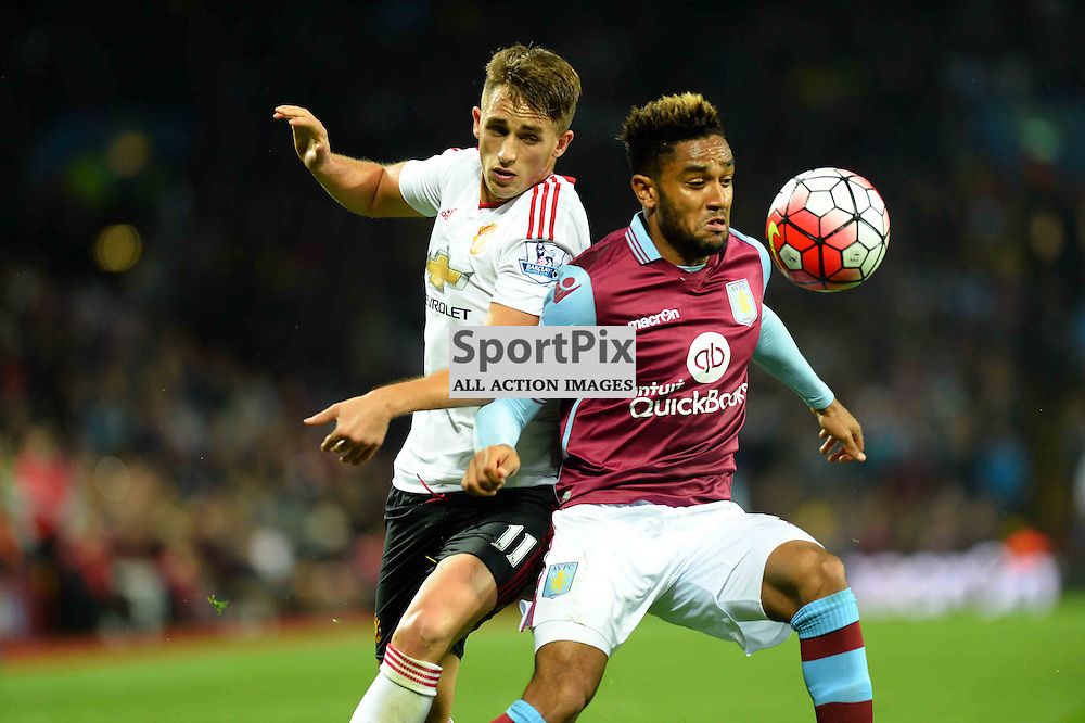 Villa player Jordan Amavi fights for the ball with United player Adnan Januzaj