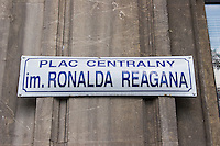 Street sign showing Ronald Reagan Central Square in Nowa Huta Krakow Poland