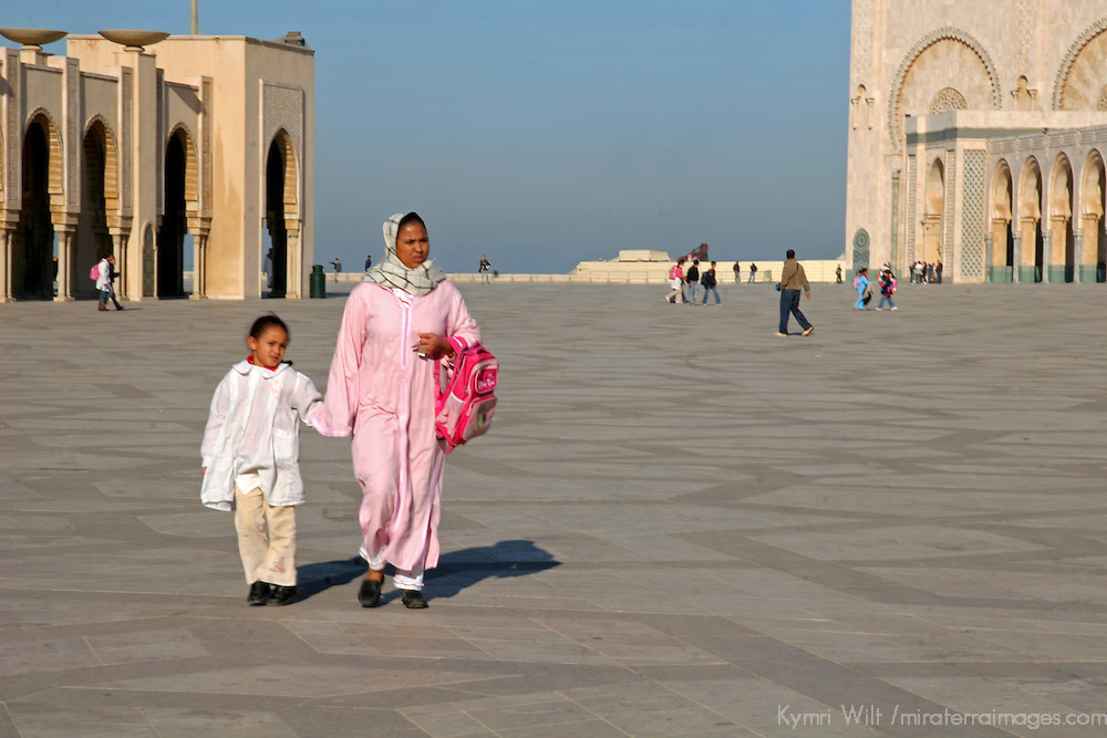 North Africa, Africa, Morocco, Casablanca. A mother and child walking at the Hassan II Mosque.