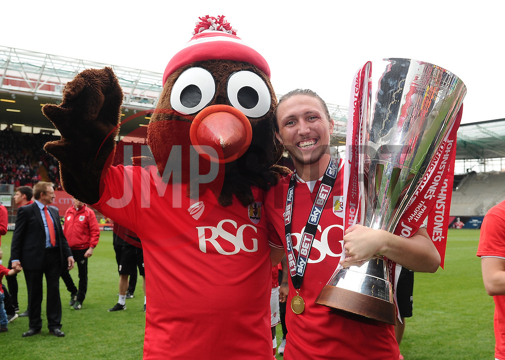 Bristol City's Luke Ayling lifts the Sky Bet League One and JPT trophy's with scrumpy  - Photo mandatory by-line: Joe Meredith/JMP - Mobile: 07966 386802 - 03/05/2015 - SPORT - Football - Bristol - Ashton Gate - Bristol City v Walsall - Sky Bet League One