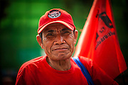 "10 DECEMBER 2012 - BANGKOK, THAILAND:   A Red Shirt protestor on Ratchadamnoen Avenue in Bangkok Monday. The Thai government announced on Monday, which is Constitution Day in Thailand, that will speed up its campaign to write a new charter. December 10 marks passage of the first permanent constitution in 1932 and Thailand's transition from an absolute monarchy to a constitutional monarchy. Several thousand ""Red Shirts,"" supporters of ousted and exiled Prime Minister Thaksin Shinawatra, motorcaded through the city, stopping at government offices and the offices of the Pheu Thai ruling party to present demands for a new charter.       PHOTO BY JACK KURTZ"