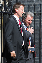 Downing Street, London, May 3rd 2016. Health Secretary Jeremy Hunt and Chancellor of the Duchy of Lancaster and Policy Advisor Oliver Letwin (R) leave 10 Downing Street following the weekly cabinet meeting. ©Paul Davey<br /> FOR LICENCING CONTACT: Paul Davey +44 (0) 7966 016 296 paul@pauldaveycreative.co.uk
