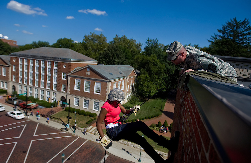 Repelling from the Bentley Hall roof, on Wednesday, September 17, Dionna Baker, a junior from Canton, receives help from a ROTC Bobcat Battalion cadre.