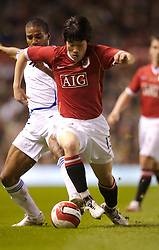 Manchester, England - Tuesday, March 13, 2007: Manchester United's Ju-sung Park in action against Europe XI's Eric Abidal during the UEFA Celebration Match at Old Trafford. (Pic by David Rawcliffe/Propaganda)