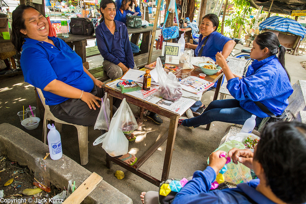 14 NOVEMBER 2012 - BANGKOK, THAILAND: Passenger boat crews relax during their shift at the Wat Sriboonreung Pier, the southern terminal of the Khlong Saen Saeb boat service. Bangkok used to be criss crossed by canals (called Khlongs in Thai) but most have been filled in and paved over. Khlong Saen Saeb is one of the few remaining khlongs in Bangkok with regular passenger boat service. Boats and ships play an important in daily life in Bangkok. Thousands of people commute to work daily on the Chao Phraya Express Boats and fast boats that ply Khlong Saen Saeb. Boats are used to haul commodities through the city to deep water ports for export.      PHOTO BY JACK KURTZ