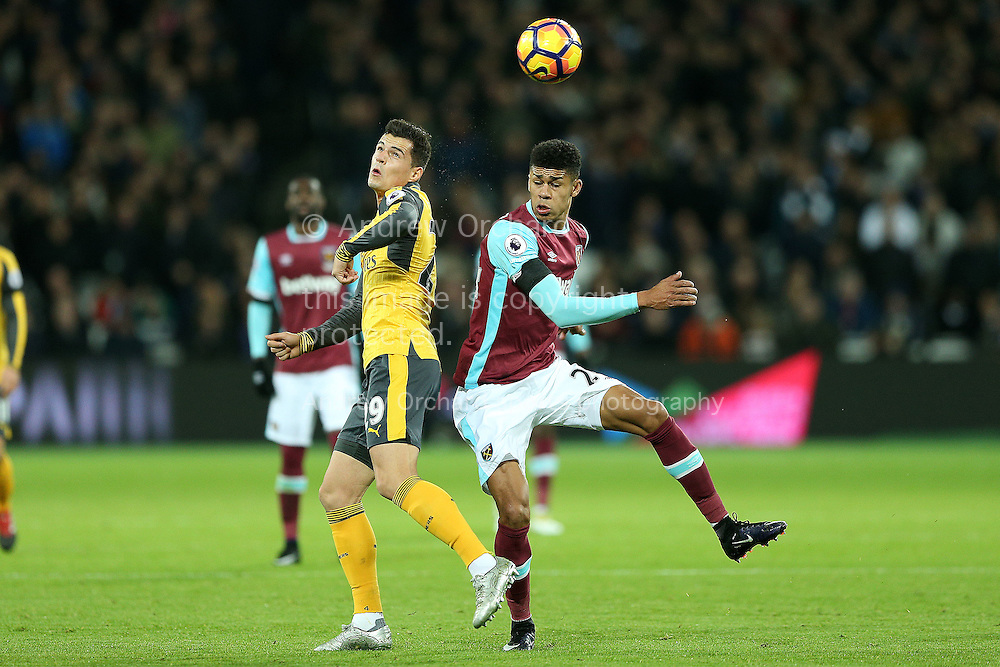 Granit Xhaka of Arsenal and Ashley Fletcher of West Ham United jump to head the ball. Premier league match, West Ham Utd v Arsenal at the London Stadium, Queen Elizabeth Olympic Park in London on Saturday 3rd December 2016.<br /> pic by John Patrick Fletcher, Andrew Orchard sports photography.