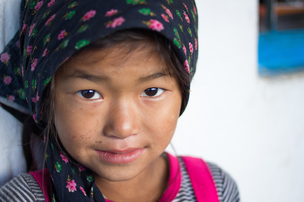 Young Nepali girl with a headscarf in the small settlement of Seduwa, along the trail to Makalu Basecamp.