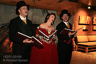 Christmas carollers perform in lodge at Grouse Mountain outside Vancouver, British Columbia, Canada.