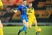Ethan Hamilton is challenged during the EFL Sky Bet League 1 match between Rochdale and AFC Wimbledon at Spotland, Rochdale, England on 19 February 2019.