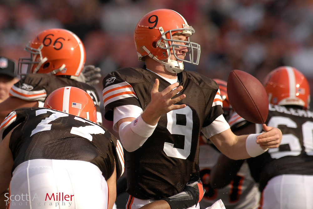 Nov. 26, 2006; Cleveland, OH, USA;  Cleveland Browns quarterback (9) Charlie Frye fumbles the ball as he is sacked by Cincinatti Bengals defender (59) Landon Johnson in the first quarter at Cleveland Browns Stadium. ©2006 Scott A. Miller