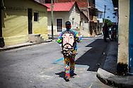 Festividad del Corpus Christi, representada en Venezuela a traves del ritual magico-religioso de los Diablos Danzantes. Los Diablos de Naiguata se identifican por pintar sus propios trajes y decorarlos con cruces, rayas y circulos, figuras que impiden que el maligno los domine. Las mascaras son en su gran mayoria animales marinos. Llevan escapularios cruzados, crucifijos y cruces de palma bendita. Naiguata, 30 Mayo 2013. (ivan gonzalez)
