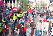 Protester standing on a bollard at the, First Criminal Justice March. Trafalgar Square, London, UK, 1st of May 1994.