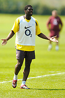 Photo: Richard Lane.<br />Arsenal Training Session. The Barclays Premiership. 11/05/2006.<br />Kolo Toure questions his teammates during training.
