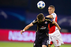 Ivo Pinto #6 of GNK Dinamo Zagreb and Kieran Gibbs #3 of Arsenal F.C. during football match between GNK Dinamo Zagreb, CRO and Arsenal FC, ENG in Group F of Group Stage of UEFA Champions League 2015/16, on September 16, 2015 in Stadium Maksimir, Zagreb, Croatia. Photo by Urban Urbanc / Sportida