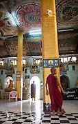 Buddhist monks inside temple, Mrauk U, Myanmar