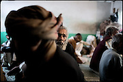 "Patients of the Edhi Rehab clinic, all drug addicts, have rest minutes before their meal at lunch time. Karachi, Pakistan, on sunday, December 07 2008.....""Pakistan is one of the countries hardest hits by the narcotics abuse into the world, during the last years it is facing a dramatic crisis as it regards the heroin consumption. The Unodc (United Nations Office on Drugs and Crime) has reported a conspicuous decline in heroin production in Southeast Asia, while damage to a big expansion in Southwest Asia. Pakistan falls under the Golden Crescent, which is one of the two major illicit opium producing centres in Asia, situated in the mountain area at the borderline between Iran, Afghanistan and Pakistan itself. .During the last 20 years drug trafficking is flourishing in the Country. It is the key transit point for Afghan drugs, including heroin, opium, morphine, and hashish, bound for Western countries, the Arab states of the Persian Gulf and Africa..Hashish and heroin seem to be the preferred drugs prevalence among males in the age bracket of 15-45 years, women comprise only 3%. More then 5% of whole country's population (constituted by around 170 milion individuals),  are regular heroin users, this abuse is conspicuous as more of an urban phenomenon. The substance is usually smoked or the smoke is inhaled, while small number of injection cases have begun to emerge in some few areas..Statistics say, drug addicts have six years of education. Heroin has been identified as the drug predominantly responsible for creating unrest in the society."""