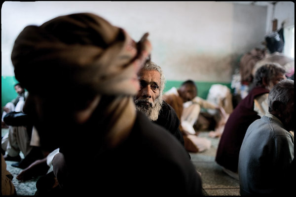 """Patients of the Edhi Rehab clinic, all drug addicts, have rest minutes before their meal at lunch time. Karachi, Pakistan, on sunday, December 07 2008.....""""Pakistan is one of the countries hardest hits by the narcotics abuse into the world, during the last years it is facing a dramatic crisis as it regards the heroin consumption. The Unodc (United Nations Office on Drugs and Crime) has reported a conspicuous decline in heroin production in Southeast Asia, while damage to a big expansion in Southwest Asia. Pakistan falls under the Golden Crescent, which is one of the two major illicit opium producing centres in Asia, situated in the mountain area at the borderline between Iran, Afghanistan and Pakistan itself. .During the last 20 years drug trafficking is flourishing in the Country. It is the key transit point for Afghan drugs, including heroin, opium, morphine, and hashish, bound for Western countries, the Arab states of the Persian Gulf and Africa..Hashish and heroin seem to be the preferred drugs prevalence among males in the age bracket of 15-45 years, women comprise only 3%. More then 5% of whole country's population (constituted by around 170 milion individuals),  are regular heroin users, this abuse is conspicuous as more of an urban phenomenon. The substance is usually smoked or the smoke is inhaled, while small number of injection cases have begun to emerge in some few areas..Statistics say, drug addicts have six years of education. Heroin has been identified as the drug predominantly responsible for creating unrest in the society."""""""