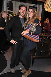 ANNABEL SIMPSON and WILL WOODHAMS with Coco the dog at a private view of jewellery and photographs by Rosie Emerson and Annoushka Ducas entitled Alchemy in association with Ruinart Champagne held at Annoushka, 41 Cadogan gardens, London SW3 on 15th September 2011.