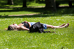 © Licensed to London News Pictures. 14/05/2019. London, UK. A woman sunbathes in London's St James's Park on a warm and sunny day in the capital. Temperatures are set to reach 19C in the capital and potentially higher in the some parts of the UK. Photo credit: Dinendra Haria/LNP