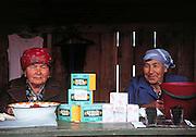 Babushkas selling tea (chai) and wild berries in Barguzin Valley, Siberia, Russia, near Lake Baikal.