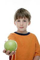 20 July 2008:  Back to School with grammar school Lytle brothers in Huntington Beach, CA.  Matthew Lytle age 6 holding a green apple for a teacher in the studio on white seamless paper silo.