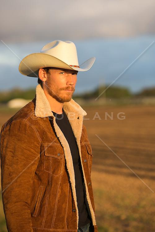portrait of a rugged cowboy in a suede  sheepskin jacket