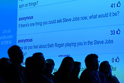 © Licensed to London News Pictures. 05/10/2016. Audience question on a projection screen for APPLE co-founder STEVE WOZNIAK gives a keynote speech on the 5th anniversary of STEVE JOBS death at the Festival of Marketing where ambitious marketers can discover, learn, celebrate and shape the future together. London, UK. Photo credit: Ray Tang/LNP