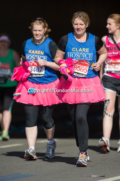 Runners appear from the tunnel at the north end of Blackfriars Bridge during the Virgin Money London Marathon 2014 on Sunday 13 April 2014<br /> Photo: Paul Gregory/Virgin Money London Marathon<br /> media@london-marathon.co.uk
