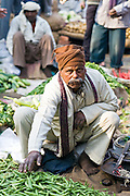 INDIA, NEW DELHI:  Vendor prepares to weigh his peas in a balance scale at the busy, crowded vegetable market in New Delhi.