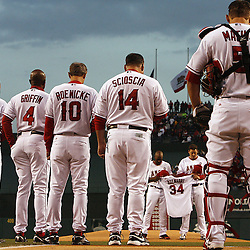 Los Angeles Angels' Torii Hunter and John Lackey hold a jersey of Nick Adenhart during a moment of silence before a baseball game at Anaheim Stadium on Friday, April 10, 2009, in Anaheim,Calif. (Pasadena Star-News/Keith Birmingham)