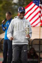 Boston Athletic Association Half Marathon; winner Lelisa Desisa on podium with victory cup wearing Boston Red Sox cap
