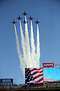 An American flag is shown on the Levi's Stadium scoreboard as six Blue Angels jets fly over the stadium after the playing of the National Anthem before the Denver Broncos NFL Super Bowl 50 football game against the Carolina Panthers on Sunday, Feb. 7, 2016 in Santa Clara, Calif. The Broncos won the game 24-10. (©Paul Anthony Spinelli)