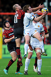 Saracens Fly-Half (#10) Charlie Hodgson and Exeter Chiefs Scrum-Half (#9) Will Chudley compete in the air for a high ball during the first half of the match - Photo mandatory by-line: Rogan Thomson/JMP - Tel: Mobile: 07966 386802 16/02/2013 - SPORT - RUGBY - Allianz Park - Barnet. Saracens v Exeter Chiefs - Aviva Premiership. This is the first Premiership match at Saracens new home ground, Allianz Park, and the first time Premiership Rugby has been played on an artificial turf pitch.