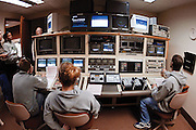 """Students work behind the scenes to prepare for a broadcast of """"Athens MidDay,"""" the noon newscast produced by students in the E.W. Scripps School of Journalism. ..Photo by Tyler Barrick"""